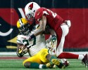Green Bay Packers running back Eddie Lacy (27) is hit by Arizona Cardinals free safety Rashad Johnson (26) during the second half of an NFL divisional playoff football game, Saturday, Jan. 16, 2016, in Glendale, Ariz. (AP Photo/Ross D. Franklin)