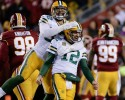 Green Bay Packers tight end Richard Rodgers (82) celebrates with quarterback Aaron Rodgers (12) after wide receiver Davante Adams caught a touchdown pass during the first half of an NFL wild-card playoff football game against the Washington Redskins in Landover, Md., Sunday, Jan. 10, 2016. (AP Photo/Mark Tenally)